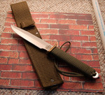 One of the best Effingham made Eks.  Green cordura sheath, green paracord handle.  New in the box, unused.